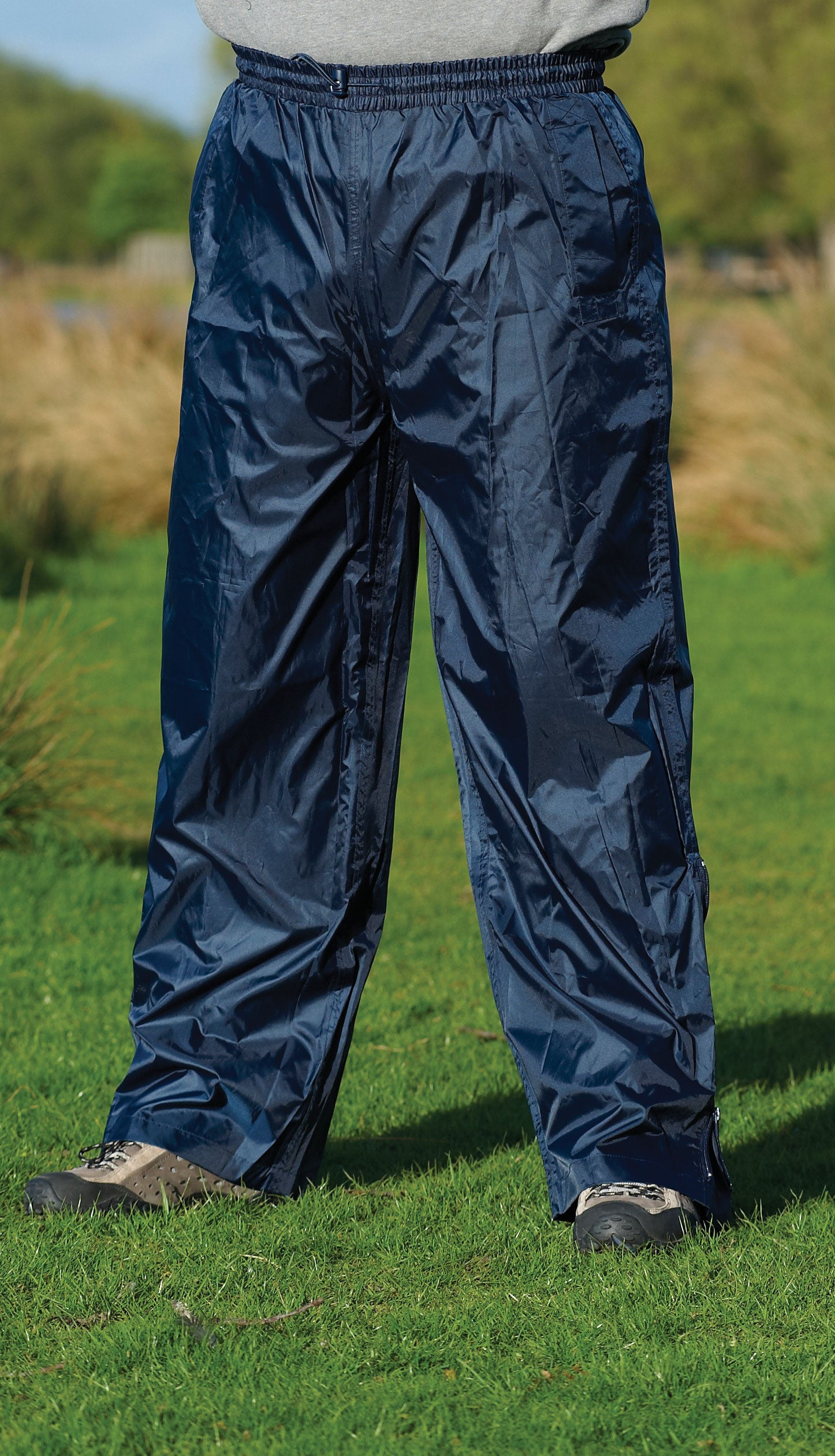 man wearing Champion Typhoon Waterproof Trousers	 navy
