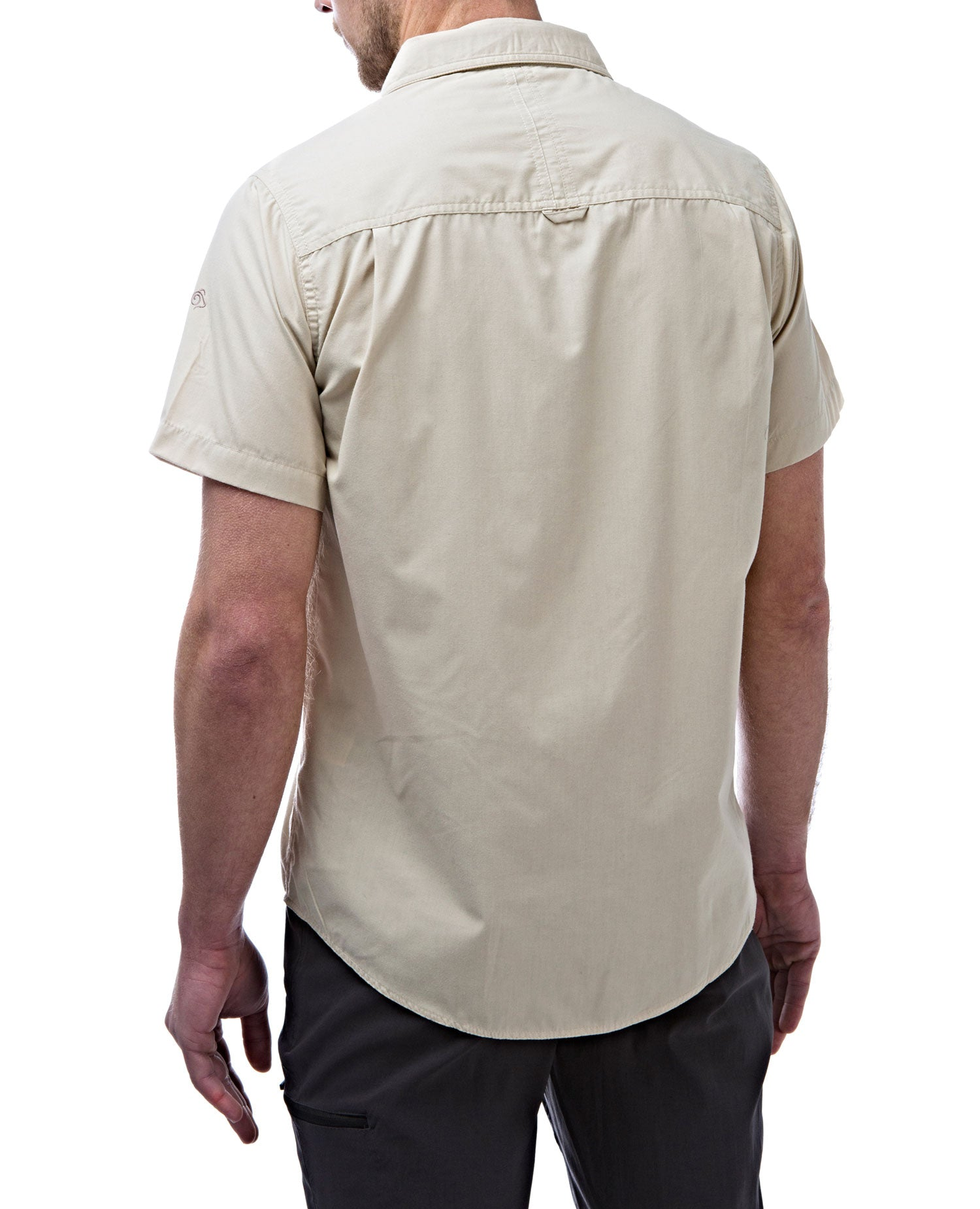 rear view oatmeal Man's Bush shirt with short sleeves