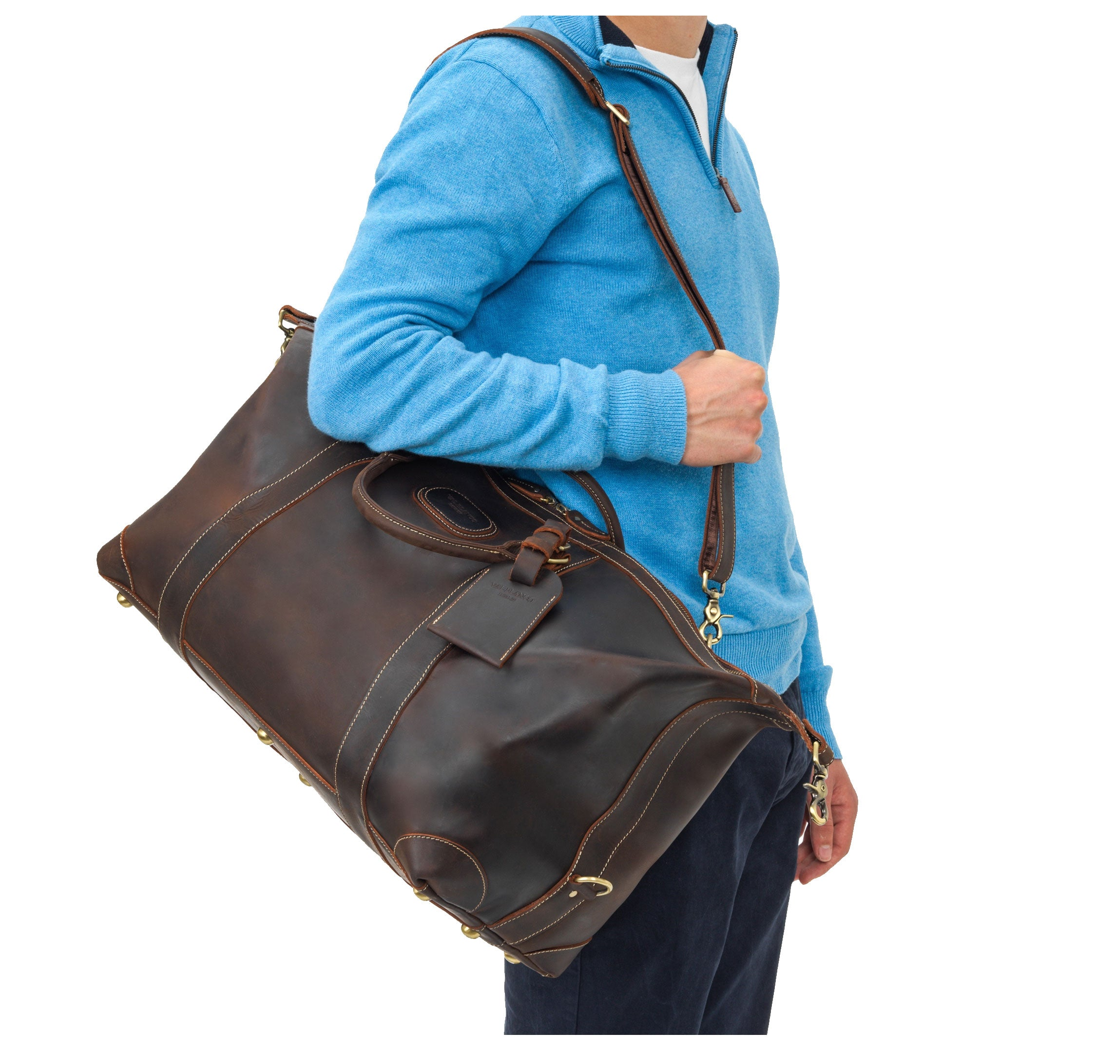 man with a leather bag over his shoulder