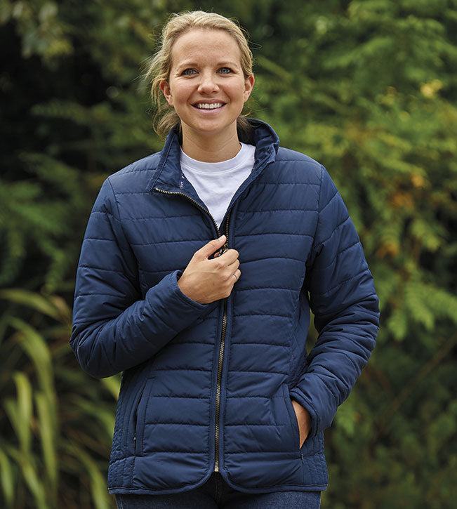 woman wears Champion Roseland Quilted Jacket