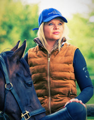 lady with a horse wearing the sporting hares windermere gilet