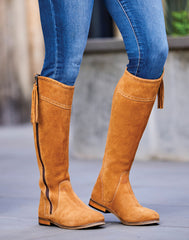 High leg suede boots with tassels on the zips