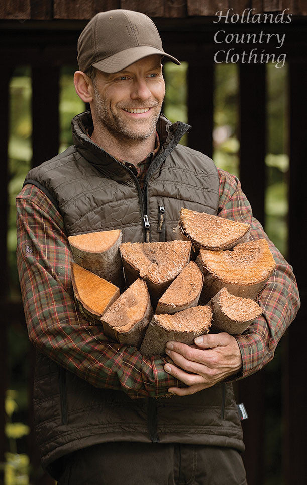 man with wood wearing verdun gilet