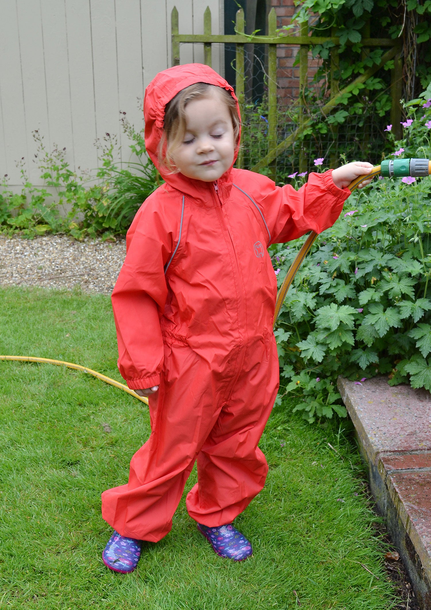 Watering the flowers in Pink Girl in Splashaway Rainsuit