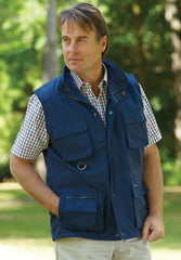 man wearing navy travel vest with lots of secure pockets