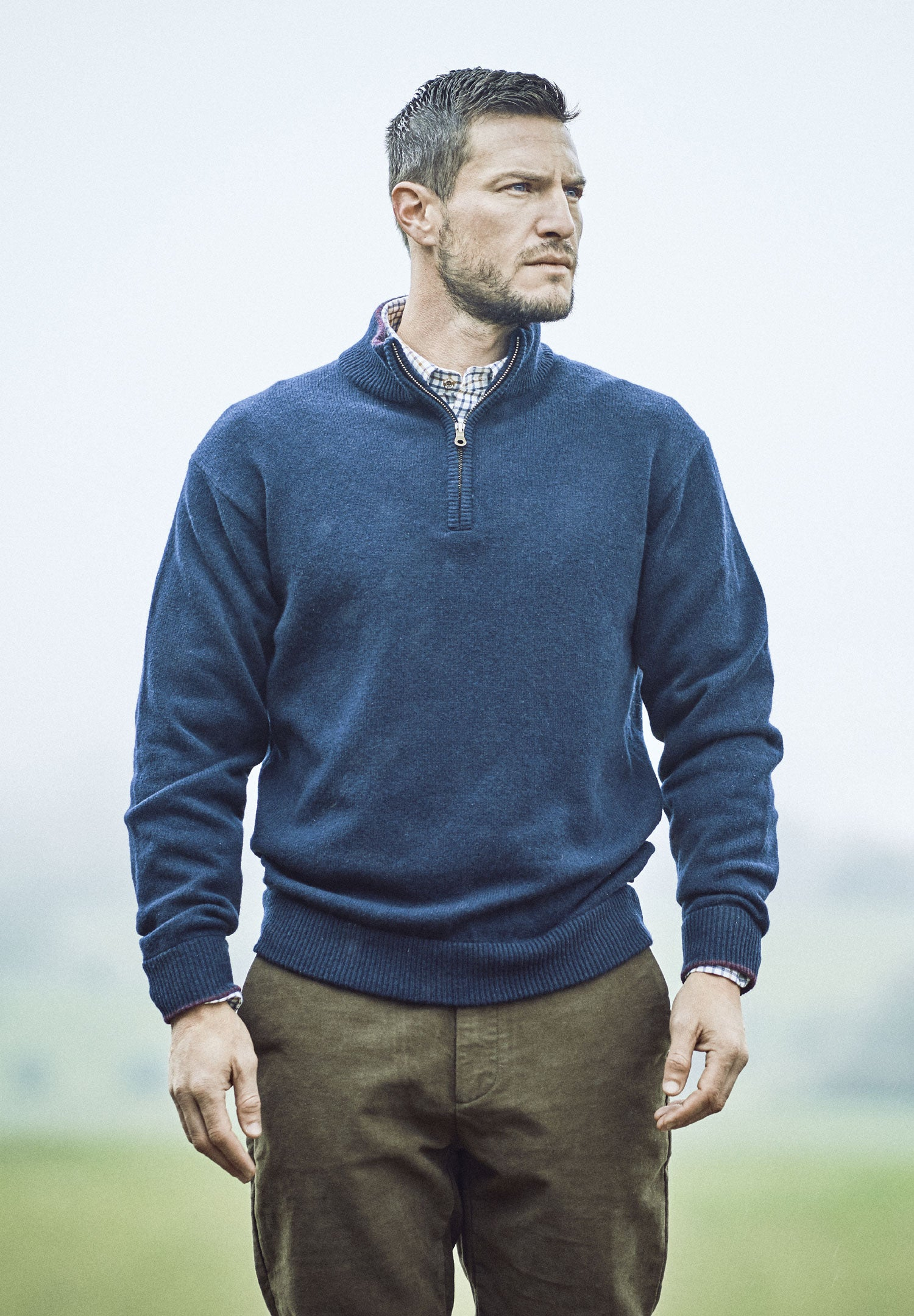 Man wearing Lambswool Zip Neck Pullover by Musto