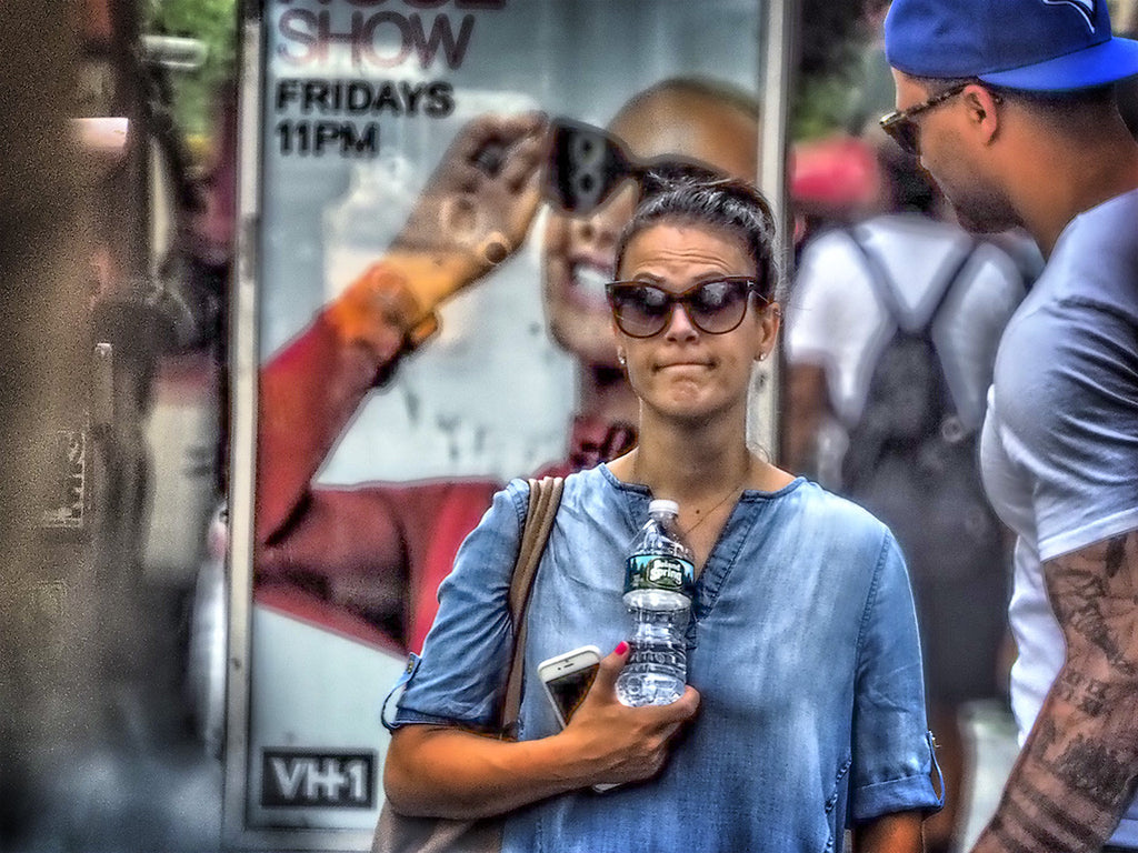 Woman With Water Bottle and Sunglasses