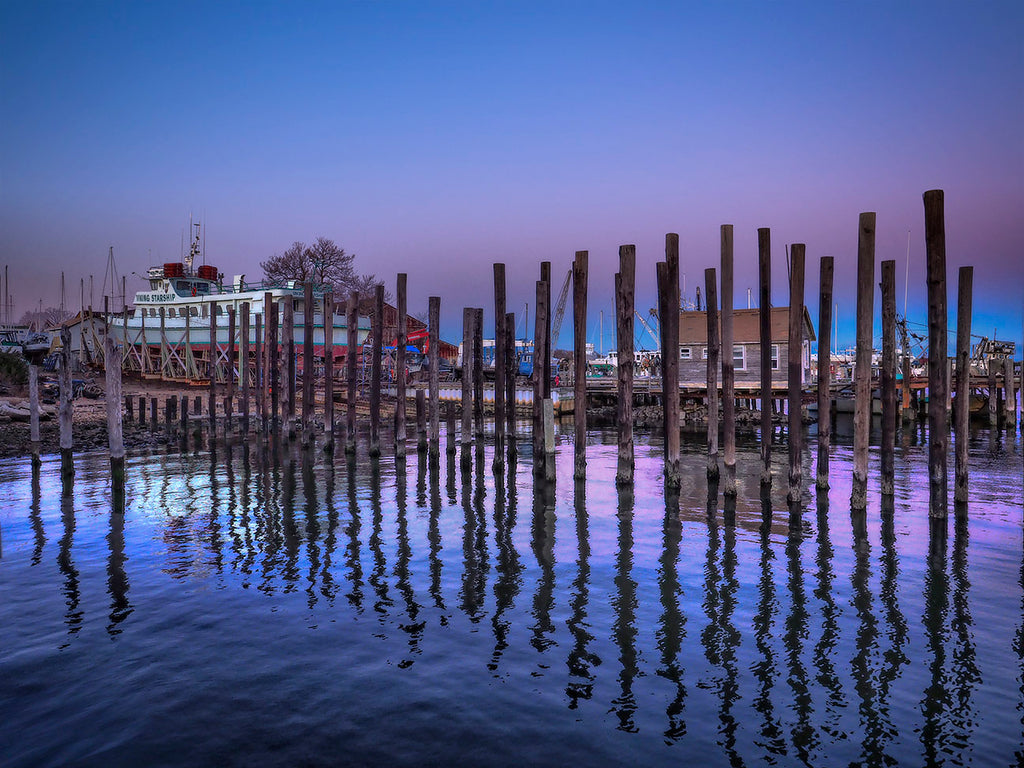 Pier Pilings And Boat
