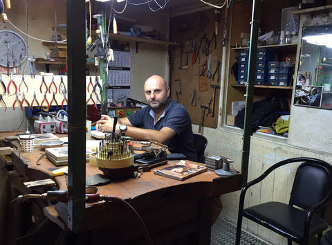 master silversmith Eren Ozler sitting at his workshop desk in Imam Ali Han, the Grand Bazaar, Istanbul, Turkey