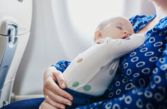 9 Tips That'll Take the Stress Out of Flying With a Baby