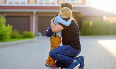 how to connect after a tantrum - child and father hugging outside