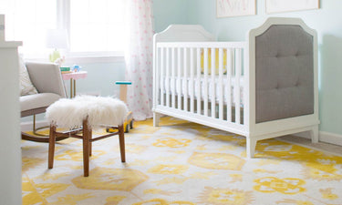 yellow-nursery-with-crib