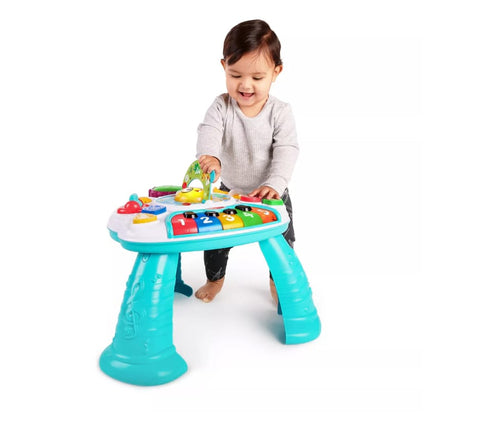 Toddler playing on an activity table