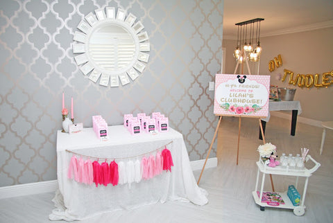 Minnie-mouse themed birthday party with balloons that spell TWO-DLES.