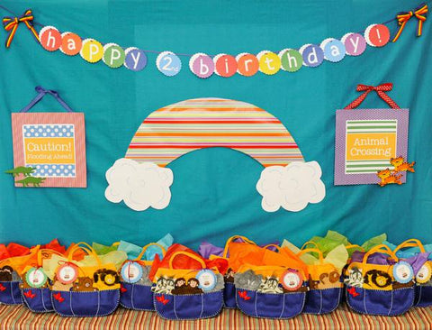 Noah's ark-themed 2nd birthday party with rainbow decor and ark-shaped goodie bags.