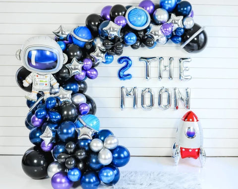 """Space-themed ballon garland with balloon letters spelling out """"Love You Two the Moon"""""""