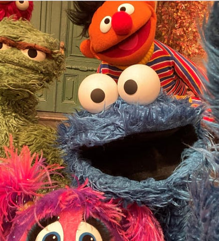 Sesame Street characters Cookie Monster, Ernie, and Oscar, on a video call