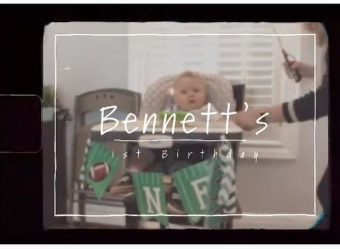 "Video still from a first birthday party video compilation that reads ""Bennett's 1st Birthday"""