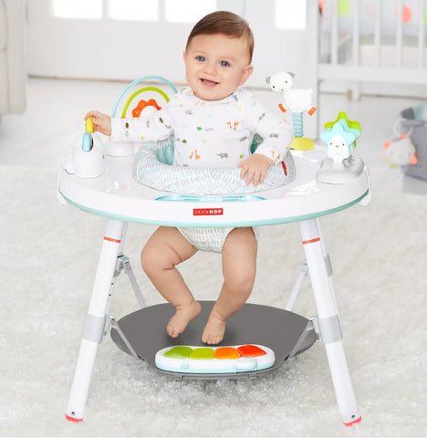 Baby plays in an exercise center