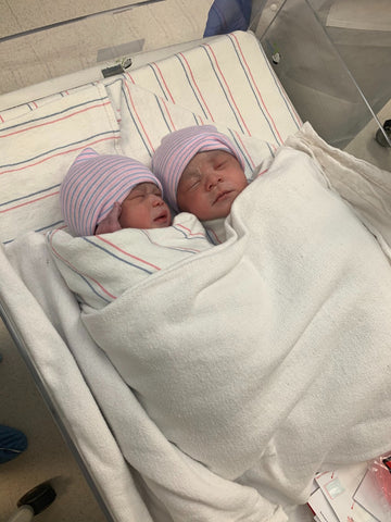 Twin newborns swaddled at the hospital