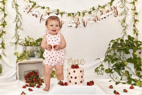 Baby and smash cake decorated with strawberries.