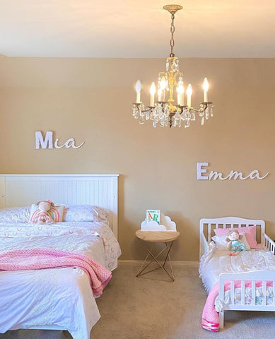 Shared kids' room with a twin-size bed and a small toddler bed