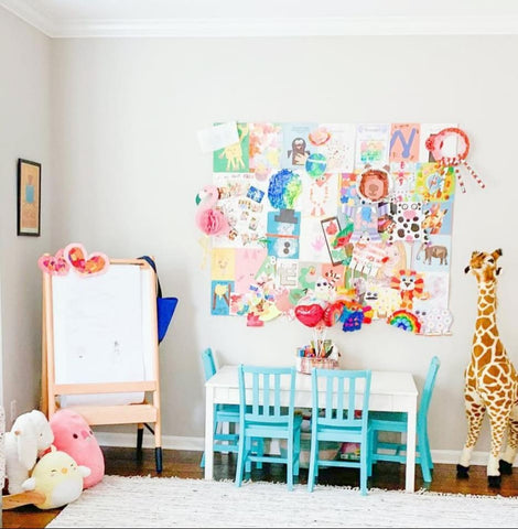 Bulletin board decorated with child's artwork