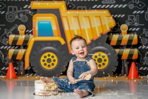 Baby and construction-vehicle-themed smash cake.
