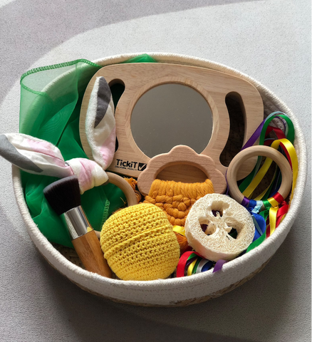 Basket filled with sensory baby toys