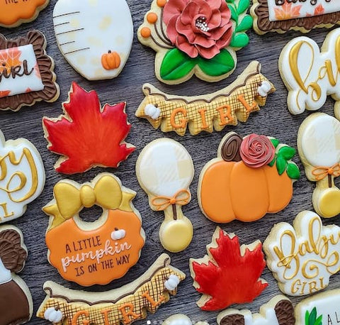 Colorful leaf and pumpkin cookies for a fall baby shower