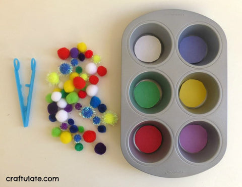 Plastic tongs, colorful pom-poms, and a muffin tin.