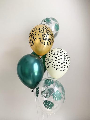 "Animal- and leaf-print balloons used for a ""wild one""-themed first birthday."