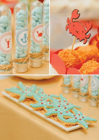 Ocean-themed first birthday party treats, including starfish-shaped sugar cookies.