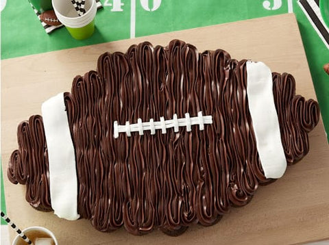 Chocolate frosted cupcake cake that looks like a football for a fall baby shower