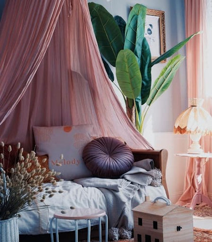 Sophisticated looking toddler room with a mauve color scheme.