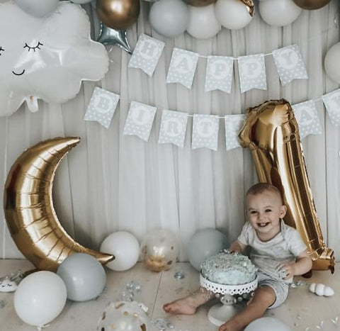 Silver and gold smash cake and baby.