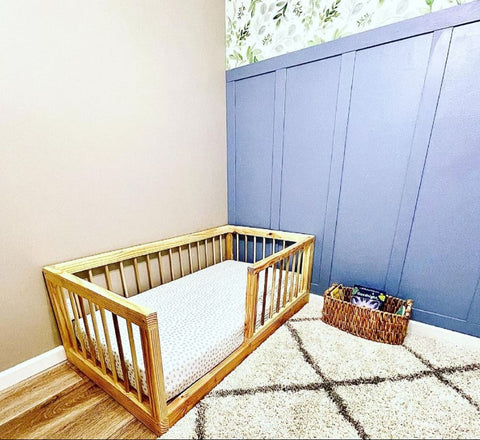 Toddler floor bed in a Montessori-style nursery