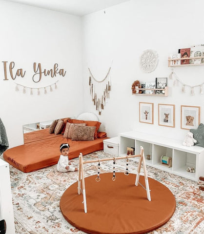 Montessori nursery with soft playspace in center of room