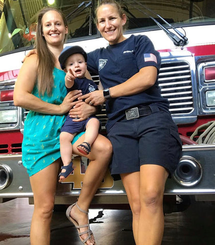 Morgan and Casey Dresser: Two moms holding child at firehouse