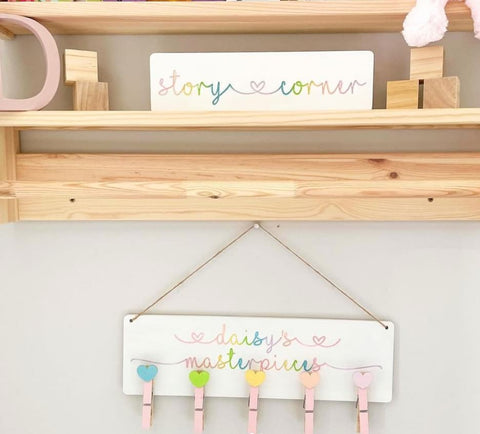 Personalized painted plaque with clothespins to display child's artwork
