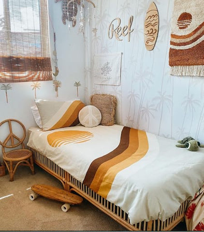 Surf-themed toddler room with an orange and brown retro-looking color scheme.