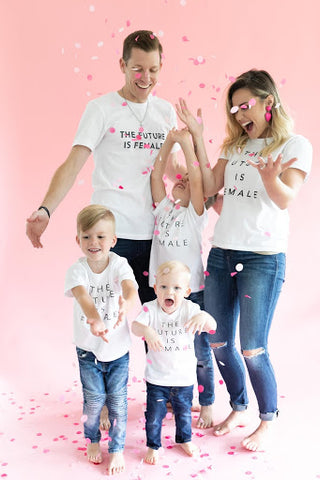 Sibling pregnancy announcement - family wearing future is female shirts