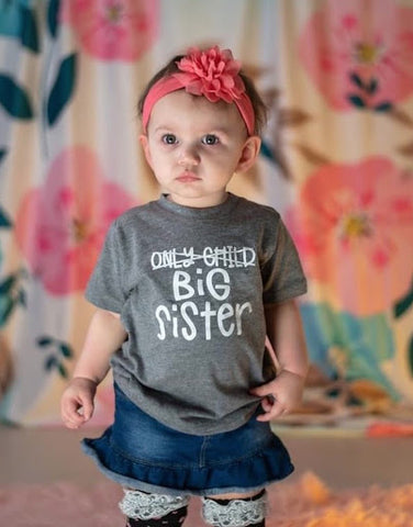 sibling pregnancy announcement - big sister wearing baby announcement t-shirt