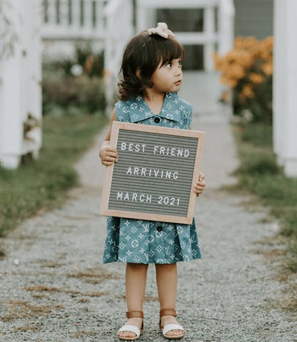 Sibling pregnancy announcement letterboard