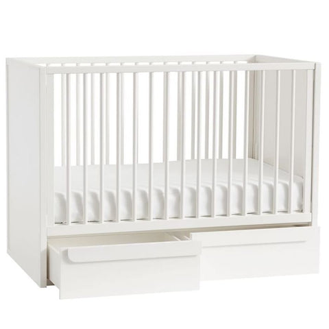 Crib with storage in the bottom.