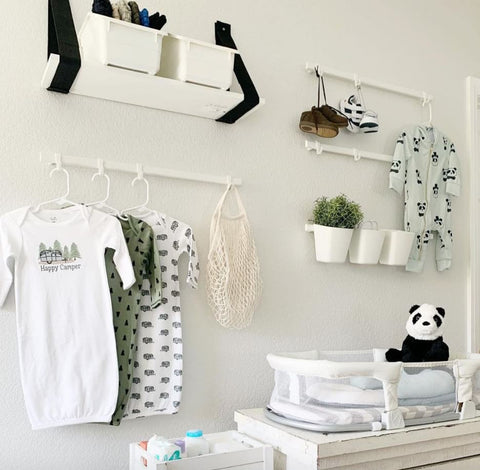 Nursery wall with hanging shelves.