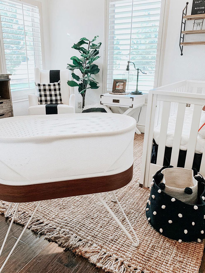 baby nursery with SNOO bassinet and black and white patterns