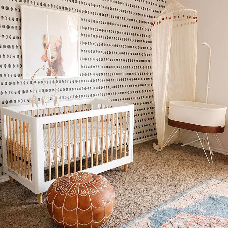 gender neutral nursery with camel picture and SNOO