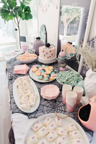Ghost, cobweb, spider, and Frankenstein treats and table decor for a fall baby shower