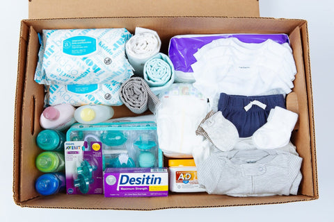 Welcome baby box filled with baby essentials.